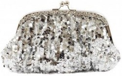 Can I carry a silver clutch bag with a red dress & black heels?